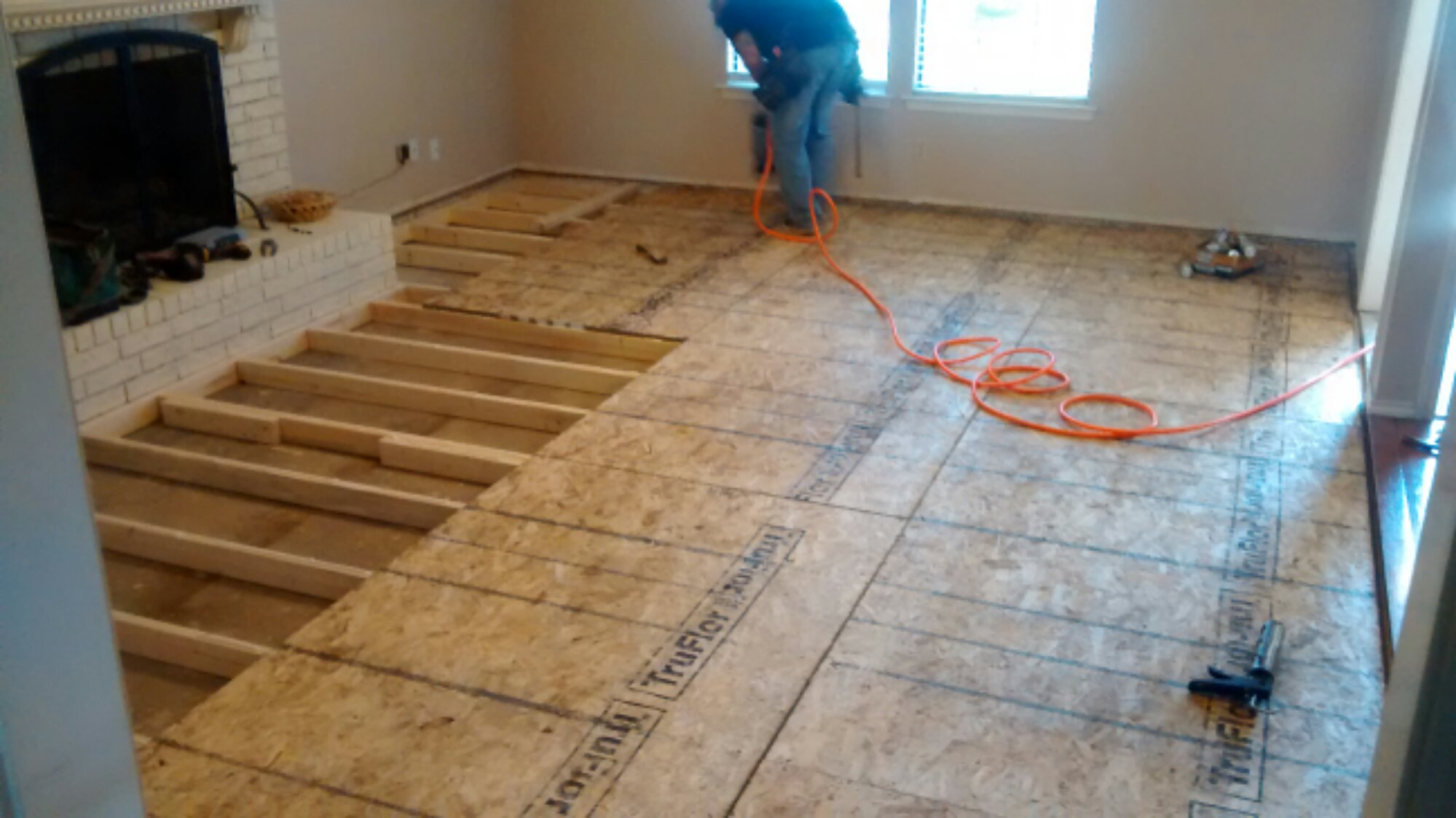 Sunken living room renov8z for How to build a floor for a house